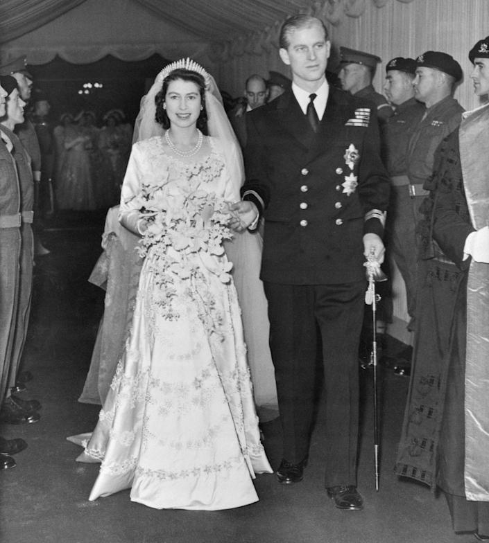 """<p>When Queen Elizabeth married Prince Philip in 1947, it was only two years after World War II and the country was still on war rations. The extravagant fabric for her dress was paid for with <a href=""""https://www.townandcountrymag.com/society/tradition/a13438510/queen-elizabeth-wedding-dress/"""" rel=""""nofollow noopener"""" target=""""_blank"""" data-ylk=""""slk:ration coupons the princess saved up herself"""" class=""""link rapid-noclick-resp"""">ration coupons the princess saved up herself</a>, plus an additional 200 rations she was granted. Some citizens tried to contribute to the gown by sending in their own rations, but it was illegal to transfer coupons, so they were returned to the senders. </p>"""
