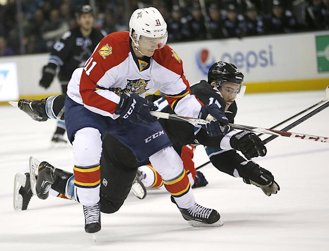 Florida Panthers center Jonathan Huberdeau (11) vies for the puck against San Jose Sharks left wing James Sheppard (15) during the first period of an NHL hockey game Thursday, Nov. 20, 2014, in San Jose, Calif. (AP Photo/Tony Avelar)