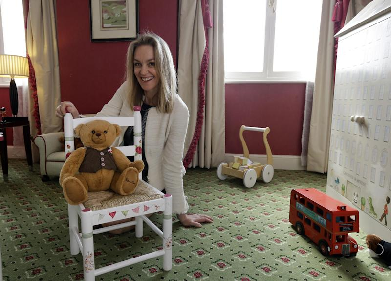 In this Tuesday, April 30, 2013 photo, Lucinda Croft, the managing director of Dragons, a small British family business that was also tapped to design nurseries for British royals, poses for the photographer as she showcases a hotel nursery suite at a central London hotel. Britain's Prince William and Kate, formally known as the Duchess of Cambridge, plan to move into apartments at London's Kensington Palace soon after the baby is born in July. Few will ever get a glimpse inside the room where the future British monarch will grow up, but the designers hired by late Princess Diana to create her sons' William and Harry's nursery at the palace can offer some expert hints.(AP Photo/Lefteris Pitarakis)
