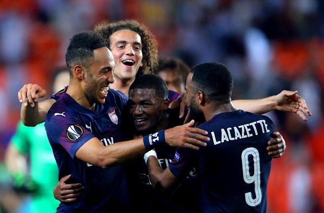 Arsenal's Pierre-Emerick Aubameyang (left), Matteo Guendouzi, Ainsley Maitland-Niles and Alexandre Lacazette celebrate the results at the end of the UEFA Europa League, Semi Final, Second Leg at the Camp de Mestalla, Valencia. (Photo by Nick Potts/PA Images via Getty Images)