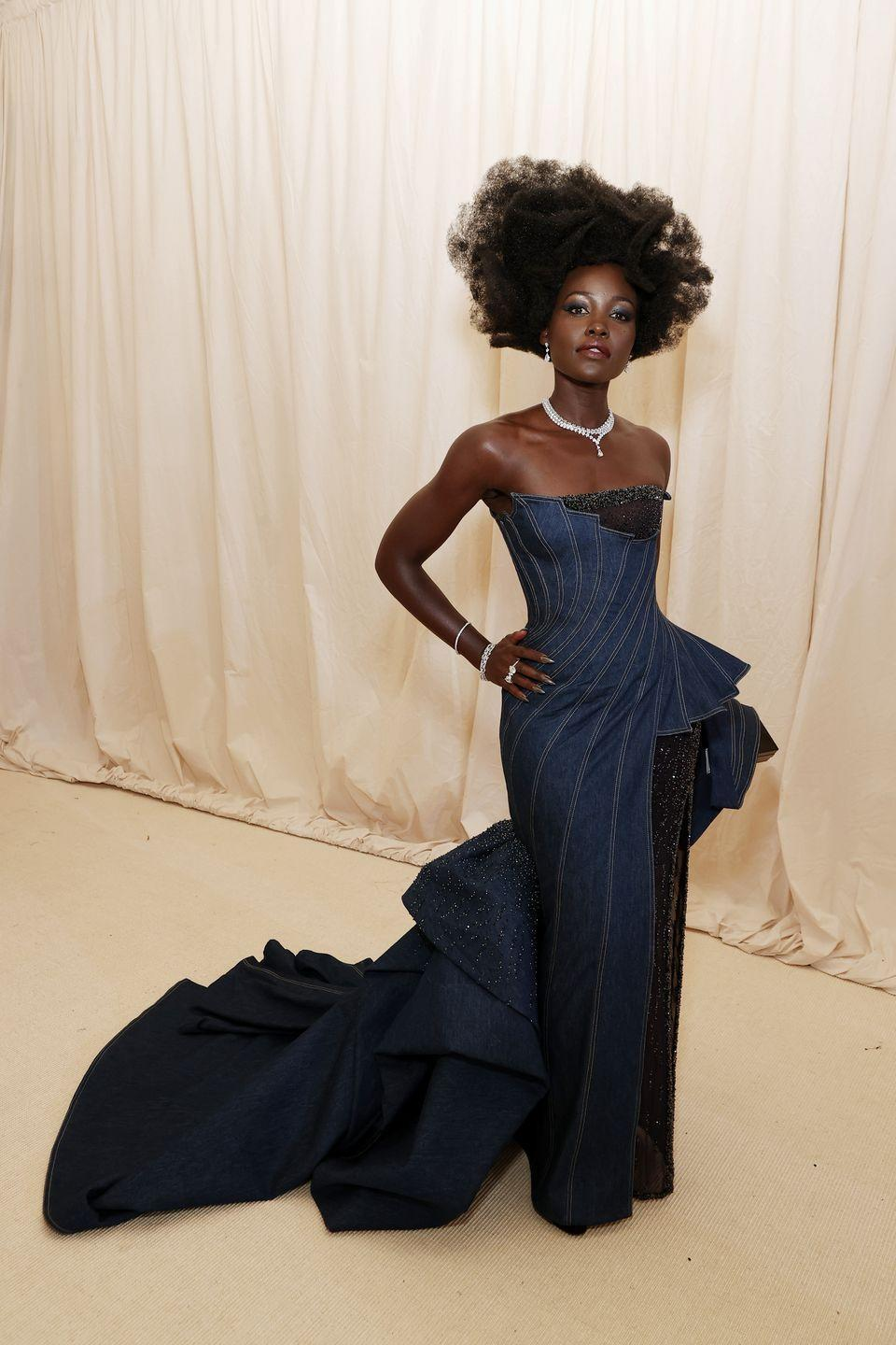 <p>While there was plenty of amazing fashion to be seen last night, the Met Gala theme of 'American Independence' was not always obvious with every single look. However, Lupita Nyong'o ticked all the right boxes with her denim Versace ballgown, which definitely nodded to all things USA.</p>