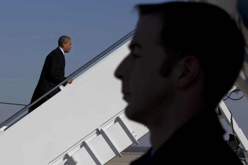 President Barack Obama boards Air Force One at Andrews Air Force Base, Md., Friday, Feb. 7, 2014, prior to departure to Michigan where he is expected to speak about the farm bill. (AP Photo/Jacquelyn Martin)