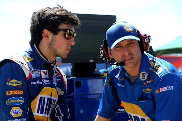 CHARLOTTE, NC - MAY 24: Chase Elliott, driver of the #9 NAPA AUTO PARTS Chevrolet, talks to his crew chief, Greg Ives, during qualifying for the NASCAR Nationwide Series History 300 at Charlotte Motor Speedway on May 24, 2014 in Charlotte, North Carolina. (Photo by Jerry Markland/Getty Images)