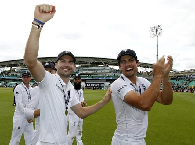 England's James Anderson (L) and Alastair Cook celebrate their win in the Test and series against India at The Oval in London on August 17, 2014 (AFP Photo/Ian Kington)