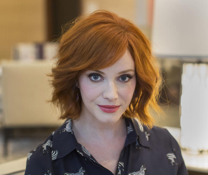 """Actress Christina Hendricks, from the AMC series """"Mad Men,"""" poses for a portrait at the Langham Hotel in Chicago, on Thursday, Aug. 22, 2013. Hendricks is in Chicago to host the opening of the city's Magnificent Mile Shopping Festival. (AP Photo/Scott Eisen)"""