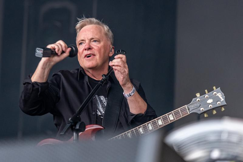 TRINITY COLLEGE, DUBLIN, IRELAND - 2019/07/07: Lead vocalist and guitarist Bernard Sumner performs live on stage with English rock band New Order at the Summer Series Festival in Trinity College, Dublin. (Photo by Ben Ryan/SOPA Images/LightRocket via Getty Images)