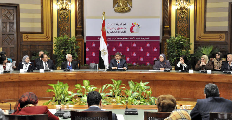 """In this image released by the Egyptian Presidency, Egyptian President Mohammed Morsi speaks at a conference on women's rights held at the Presidential palace in Cairo, Egypt, Sunday March 24, 2013. Egypt's president delivered a stern warning to his opponents on Sunday, saying he may be close to taking unspecified measures to """"protect this nation"""" two days after supporters of his Muslim Brotherhood and opposition protesters fought street battles in the worst bout of political violence in three months. (AP Photo/Egyptian Presidency)"""