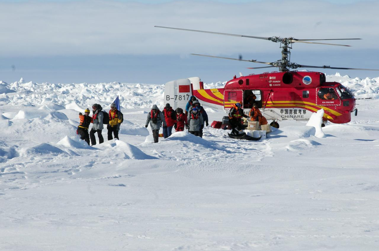 A helicopter from the Xue Long (Snow Dragon) Chinese icebreaker unloads rescued passengers from the ice-bound Russian ship, Akademik Shokalskiy, in East Antarctica, some 100 nautical miles (185 km) east of French Antarctic station Dumont D'Urville and about 1,500 nautical miles (2,800 km) south of Hobart, Tasmania, January 2, 2014, in this handout courtesy of Fairfax's Australian Antarctic Division. A rescue effort to remove 52 passengers on board a research ship that had been trapped in Antarctica ice for nine days was successful, and they were evacuated safely by helicopter, the expedition leader said on Thursday. A helicopter from the Chinese icebreaker Snow Dragon ferried the passengers in small groups several times from the Russian ship and transferred them to an Australian Antarctic supply ship, the Aurora Australis. Picture taken January 2, 2014. REUTERS/Fairfax/Australian Antarctic Division/Handout via Reuters (ANTARCTICA - Tags: ENVIRONMENT DISASTER) NO SALES. NO ARCHIVES. FOR EDITORIAL USE ONLY. NOT FOR SALE FOR MARKETING OR ADVERTISING CAMPAIGNS. THIS IMAGE HAS BEEN SUPPLIED BY A THIRD PARTY. IT IS DISTRIBUTED, EXACTLY AS RECEIVED BY REUTERS, AS A SERVICE TO CLIENTS