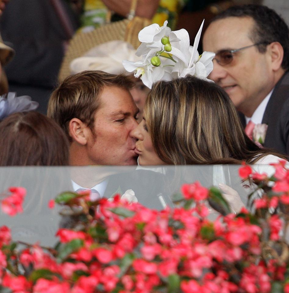 MELBOURNE, AUSTRALIA - NOVEMBER 03:  Shane Warne and Elizabeth Hurley kiss in the Crown box during Crown Oaks Day at Flemington Racecourse on November 3, 2011 in Melbourne, Australia.  (Photo by John Donegan/Getty Images)
