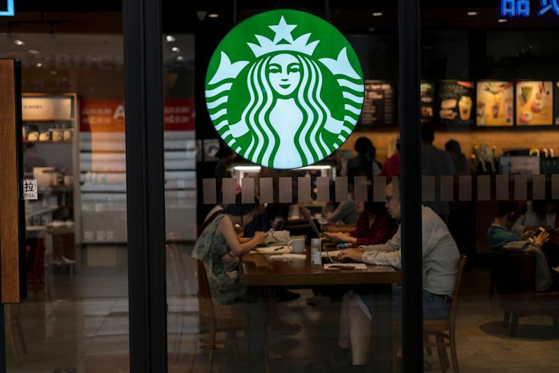BEIJING, CHINA - 2017/06/02: Customers are working on laptop in a Starbucks coffee shop. In the second quarter of 2017, Starbucks opened its stores to five new cities in China. As of now, Starbucks China has 2628 stores in 127 cities. More Chinese consumers have been influenced to drink coffee or drink more coffee, so that the turnover in Starbucks has increased by 6%, and the same store revenue in China have increased by 7%. In the next years Starbucks will continue to open one new store at every 15 hours in China. (Photo by Zhang Peng/LightRocket via Getty Images)