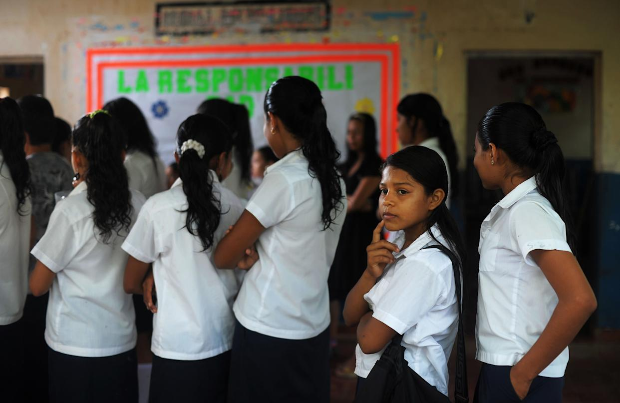 Silvia Alvarado (second from right), 10, lines up before class at the Bernd Grabs School in El Salvador on July 1, 2013.