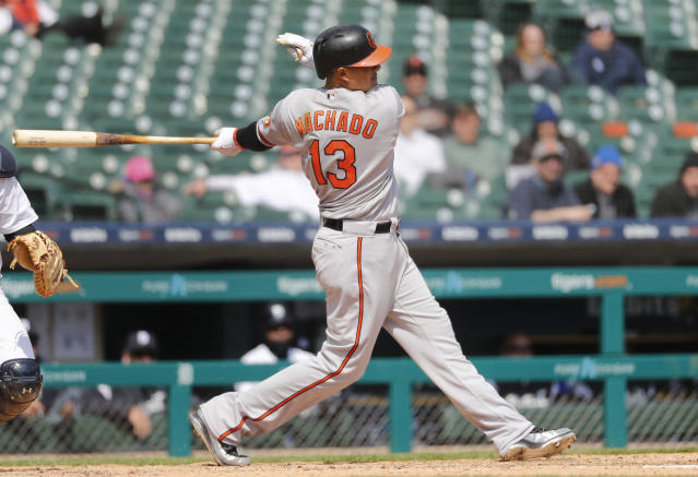 Baltimore Orioles' Manny Machado hits a one-run single against the Detroit Tigers in the eighth inning of a baseball game in Detroit, Wednesday, April 18, 2018. (AP Photo/Paul Sancya)