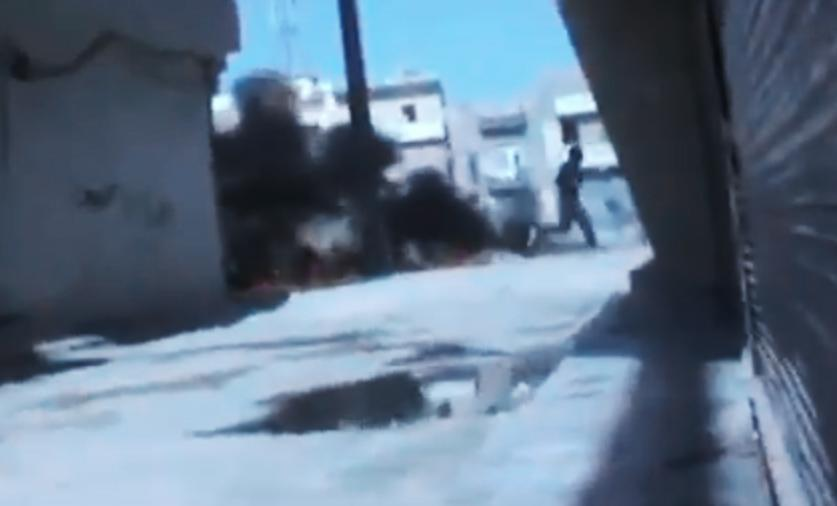 In this image made from amateur video released by the Ugarit News and accessed Monday, July 23, 2012, a Syrian government solider runs after a military tank caught on fire during clashes with Free Syrian Army soldiers in Aleppo, Syria. The Syrian regime acknowledged for the first time Monday that it possessed stockpiles of chemical and biological weapons and said it will only use them in case of a foreign attack and never internally against its own citizens. (AP Photo/Ugarit News via AP video) TV OUT, THE ASSOCIATED PRESS CANNOT INDEPENDENTLY VERIFY THE CONTENT, DATE, LOCATION OR AUTHENTICITY OF THIS MATERIAL