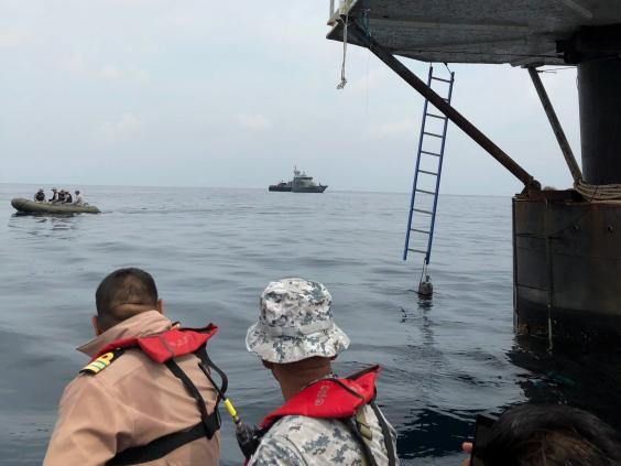 Thai naval officers approach sea dwelling on Saturday (EPA)