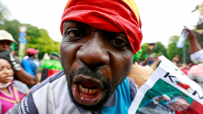 Cameroonian opposition supporters protest against French political influence outside European Union offices in Brussels on Friday.