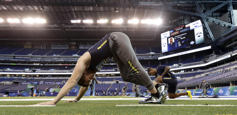 Wisconsin linebacker T.J. Watt stretches at the NFL football scouting combine Sunday, March 5, 2017, in Indianapolis. (AP Photo/David J. Phillip)