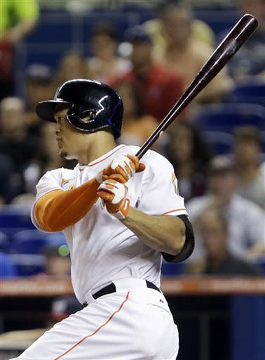 Miami Marlins' Giancarlo Stanton hits a single during the first inning of a baseball game against the Washington Nationals, Saturday, July 13, 2013 in Miami. (AP Photo/Wilfredo Lee)