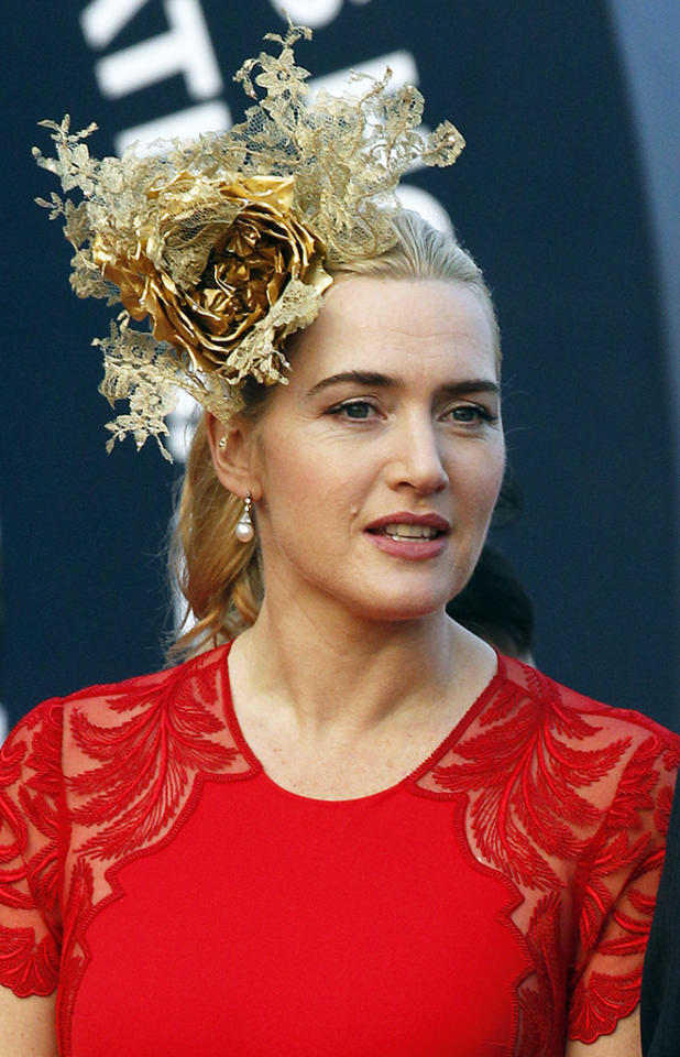 "Kate Winslet wore a gold fascinator that ""resembled a Christmas tree topper"" to the Longines Hong Kong Cup horse race."