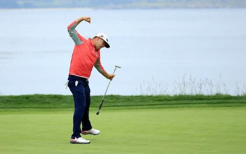 Gary Woodland of the United States celebrates on the 18th green - Credit: Getty