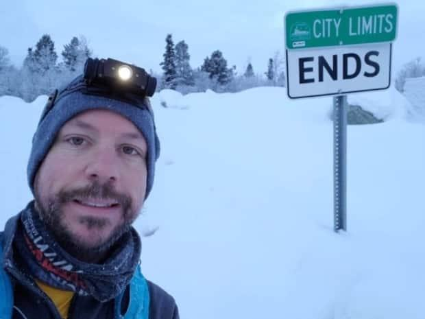 Pushing it to the city limits: Phelps takes a cold selfie at the edge of Whitehorse.
