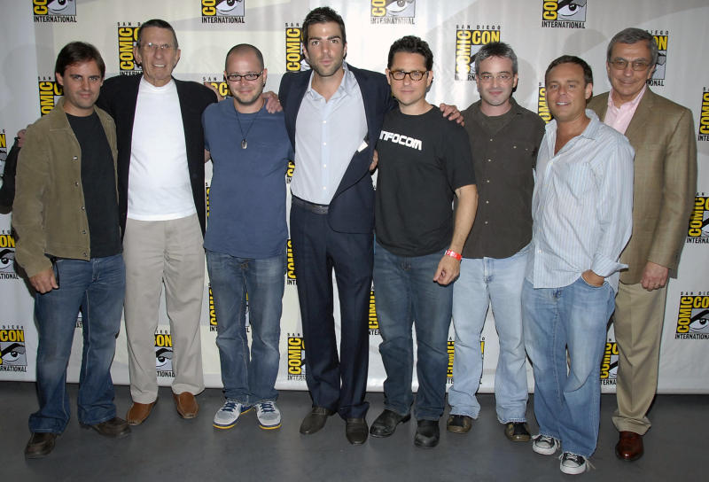 """FILE - In this July 26, 2007 file photo, from left, writer Roberto Orci, actor Leonard Nimoy, producer Damon Lindelof, actor Zachary Quinto, writer J.J. Abrams, writer Alex Kurtzman, producer Brian Burk, and producer Stratton Leopold at Comic Con in San Diego, Calif. The group was on hand to discuss their upcoming Paramount Pictures feature film """"Star Trek."""" Attending Comic-Con is often a once-in-a-lifetime opportunity for many con-goers, but it's just another summertime destination for the likes of """"The Wolverine"""" star Hugh Jackman, geeky funnyman Patton Oswalt and """"The Amazing Spider-Man"""" sequel writers Alex Kurtzman and Roberto Orci. (AP Photo/Dan Steinberg, File)"""