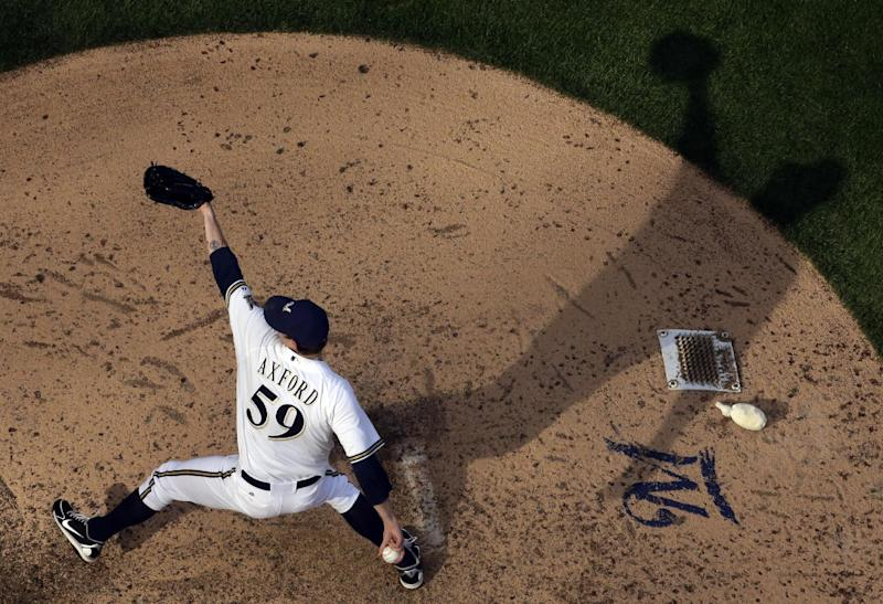Milwaukee Brewers relief pitcher John Axford throws during the eighth inning of a baseball game against the Atlanta Braves Saturday, June 22, 2013, in Milwaukee. (AP Photo/Morry Gash)