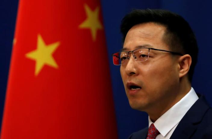 FILE PHOTO: Chinese Foreign Ministry spokesman Zhao Lijian attends a news conference in Beijing