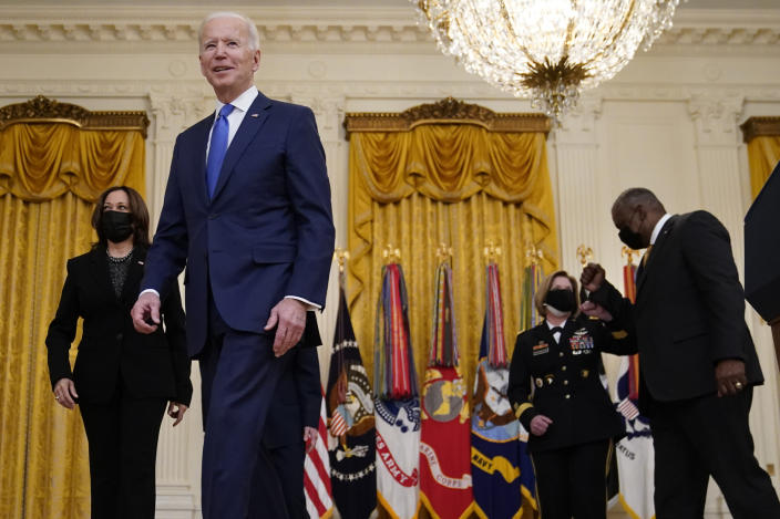 President Joe Biden leaves with Vice President Kamala Harris and Defense Secretary Lloyd Austin after speaking during an event to mark International Women's Day, Monday, March 8, 2021, in the East Room of the White House in Washington. (AP Photo/Patrick Semansky)