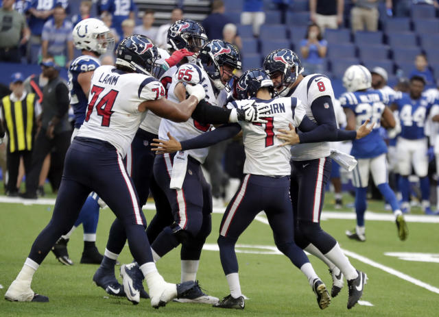 Houston Texans kicker Ka'imi Fairbairn (7) celebrates with teammates after kicking the game winning field goal during overtime of an NFL football game against the Indianapolis Colts, Sunday, Sept. 30, 2018, in Indianapolis. Houston won 37-34. (AP Photo/Michael Conroy)