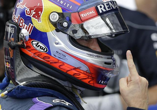 Red Bull driver Sebastian Vettel of Germany gestures as he celebrates after qualifying in pole position at the Korean Formula One Grand Prix at the Korean International Circuit in Yeongam, South Korea, Saturday, Oct. 5, 2013. (AP Photo/Lee Jin-man)