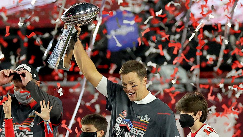 Pictured here, Tom Brady holds the trophy aloft at Super Bowl LV.