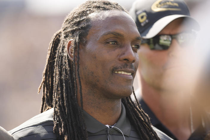 Former Colorado and NFL wide receiver Michael Westbrook smiles as he is honored in the first half of an NCAA college football game against Southern California Saturday, Oct. 2, 2021, in Boulder, Colo. (AP Photo/David Zalubowski)