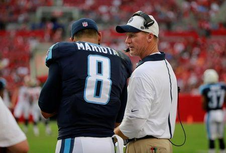 Sep 13, 2015; Tampa, FL, USA; Tennessee Titans head coach Ken Whisenhunt talks with Tennessee Titans quarterback Marcus Mariota (8) during the second half against the Tampa Bay Buccaneers at Raymond James Stadium. Mandatory Credit: Kim Klement-USA TODAY Sports