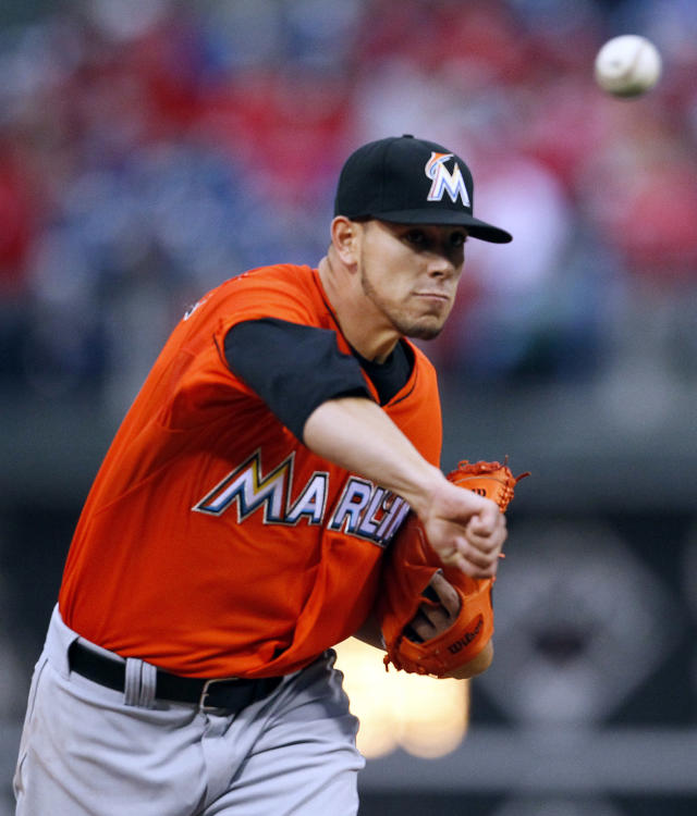 Miami Marlins' Jose Fernandez delivers a pitch during the first inning of a baseball game against the Philadelphia Phillies, Friday, April 11, 2014, in Philadelphia. (AP Photo/Tom Mihalek)