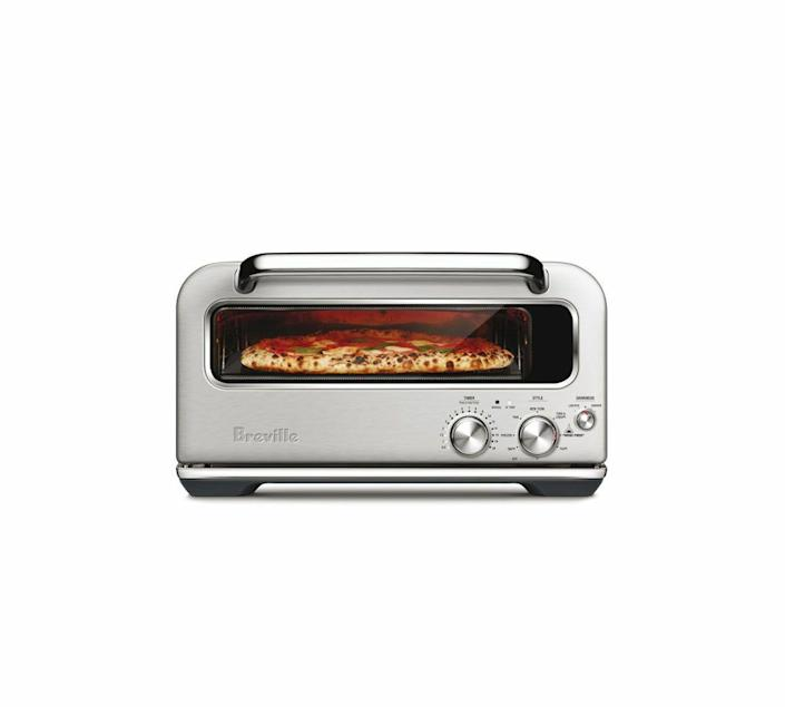 """<p>williams-sonoma.com</p><p><strong>$999.95</strong></p><p><a href=""""https://go.redirectingat.com?id=74968X1596630&url=https%3A%2F%2Fwww.williams-sonoma.com%2Fproducts%2Fbreville-pizzaiolo&sref=https%3A%2F%2Fwww.popularmechanics.com%2Fhome%2Fg37002009%2Fbest-kitchen-appliances-2021%2F"""" rel=""""nofollow noopener"""" target=""""_blank"""" data-ylk=""""slk:Shop Now"""" class=""""link rapid-noclick-resp"""">Shop Now</a></p><p>In Italy, a pizzaiolo is a person who makes pizza. The name is fitting here as this countertop wonder is a near-perfect personal- pizza maker. You still have to make (or buy) the dough and layer on the sauce and cheese. But with temps up to 750 degrees and a quality pizza stone, this little appliance turns out pie after pie that's bubbly with the right amount of char. Choose between preprogrammed and manual controls to customize cooking. Go for a thin and cheesy Neopolitan one night and a thick and crunchy pan the next.</p>"""
