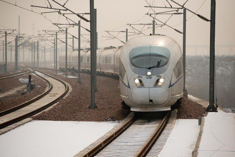 A high-speed train arrives at a platform in Hebei Province, south of Beijing, on December 22, 2012. China on Saturday showed off the final link of the world's longest high-speed rail route set to begin whisking passengers from Beijing to Guangzhou next week in a third of the time currently required
