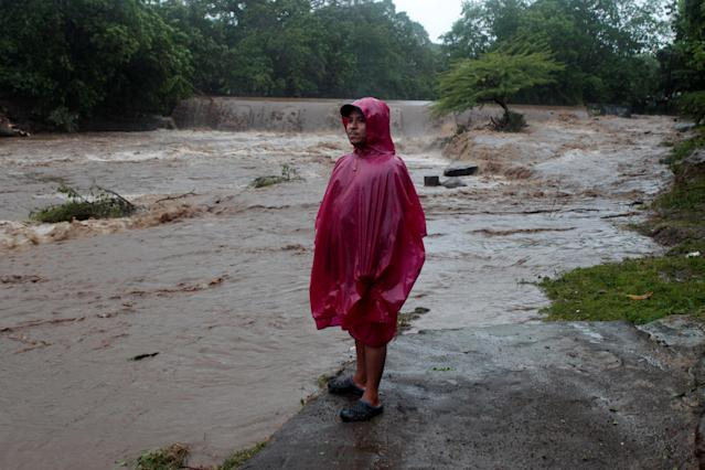<p>A resident stands on the shore of the Masachapa river, flooded by heavy rains by Tropical Storm Nate in the outskirts of Managua, Nicaragua, Oct. 5, 2017. (Photo: Oswaldo Rivas/Reuters) </p>
