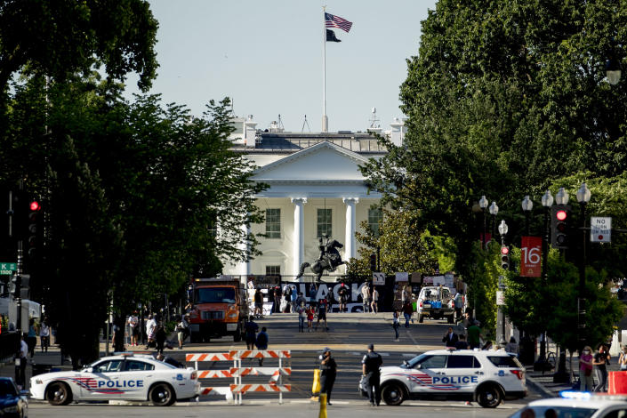 16th Street remains closed to traffic as demonstrators protest, Monday, June 8, 2020, near the White House in Washington, over the death of George Floyd, a black man who was in police custody in Minneapolis. Floyd died after being restrained by Minneapolis police officers. (AP Photo/Andrew Harnik)