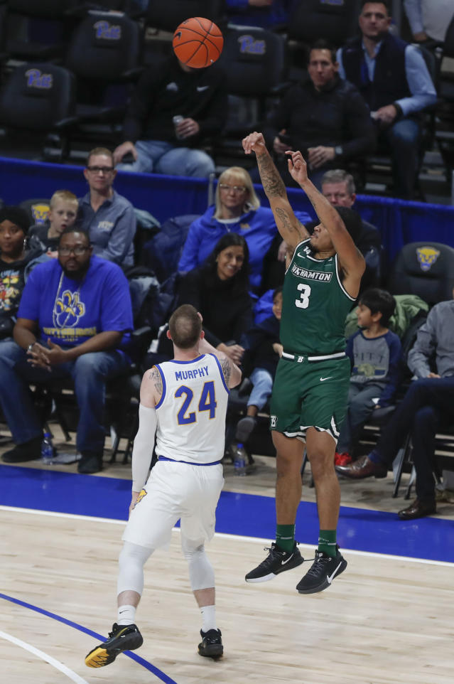 Binghamton's Sam Sessoms (3) tries for a 3-pointer as Pittsburgh's Ryan Murphy (24) watches during the second half of an NCAA college basketball game Friday, Dec. 20, 2019, in Pittsburgh. (AP Photo/Keith Srakocic)