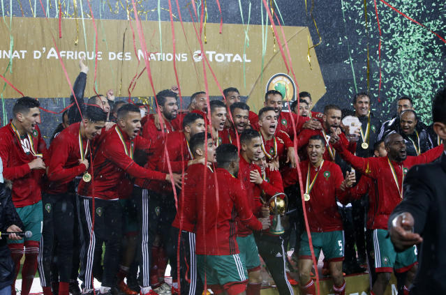 FILE - A Sunday, Feb. 4, 2018 file photo showing Morocco's players celebrating on the podium after defeating Nigeria in the final of the CHAN (African Nations Championship) soccer tournament at the Mohammed V stadium in Casablanca, Morocco. Morocco's stadiums require significant upgrades to get close to matching the infrastructure boasted by the North Americans, whose bid includes 16 NFL venues awash in the luxury seating required by FIFA. But if Morocco is not struck off by a FIFA task force lacking true independence, the vote could be closer than anticipated in part due to new procedures intended to signal a break from the secrecy of the past. (AP Photo/Abdeljalil Bounhar, File)