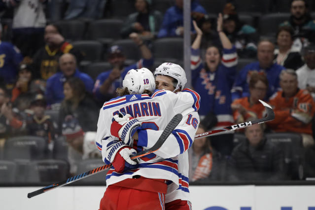 New York Rangers' Artemi Panarin (10) celebrates his goal with Ryan Strome (16) during the first period of an NHL hockey game against the Anaheim Ducks Saturday, Dec. 14, 2019, in Anaheim, Calif. (AP Photo/Marcio Jose Sanchez)