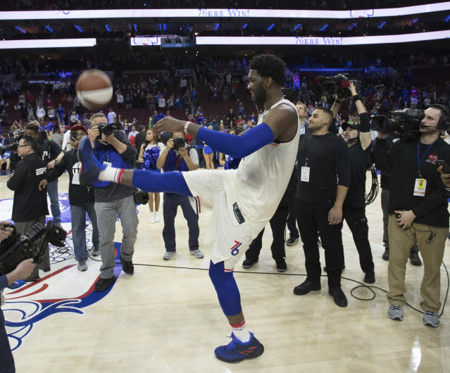 <p> Philadelphia 76ers' Joel Embiid, of Cameroon, kicks the ball into the stands after the second half in Game 5 of a first-round NBA basketball playoff series against the Miami Heat, Tuesday, April 24, 2018, in Philadelphia. The 76ers won 104-91. (AP Photo/Chris Szagola) </p>