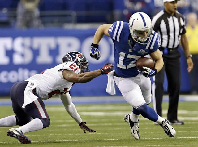 Indianapolis Colts receiver Griff Whalen, right, gets past Houston Texans cornerback Brice McCain after making a catch during the first half of an NFL football game in Indianapolis, Sunday, Dec. 15, 2013. (AP Photo/AJ Mast)