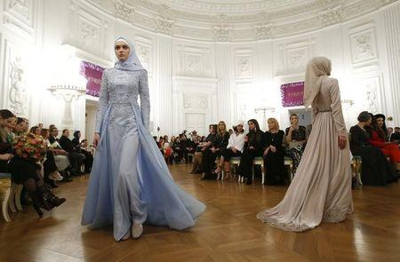 Models present creations during a show of the Firdaws fashion house at the Mercedes-Benz Fashion Week Russia in Moscow