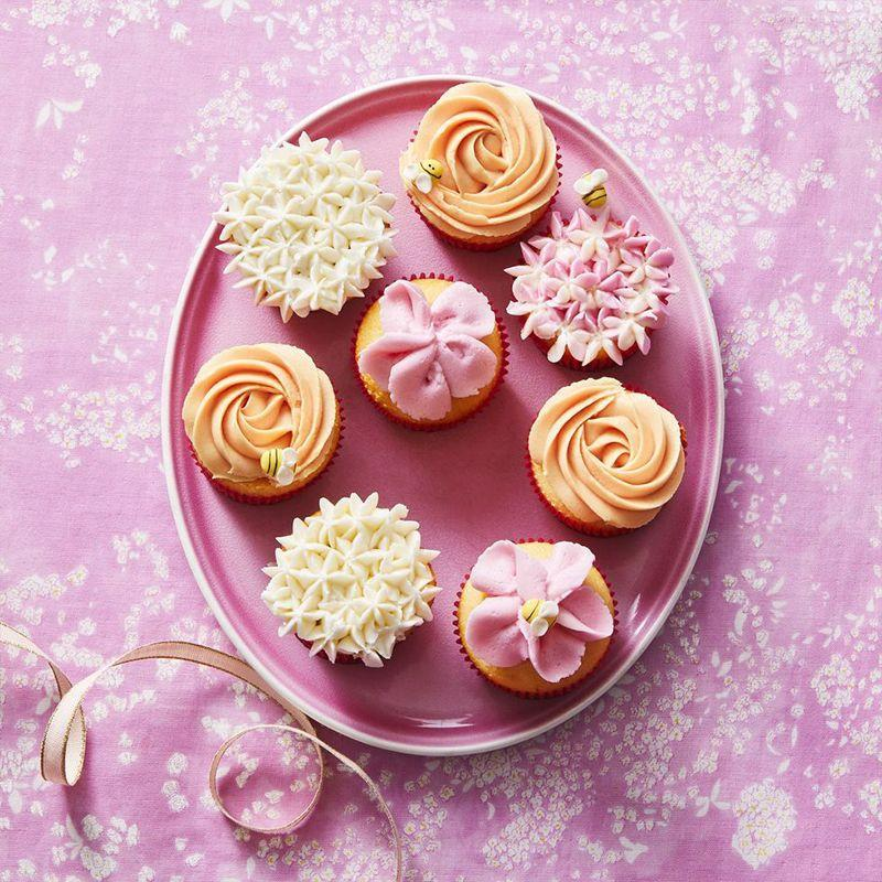 """<p>You can never go wrong with a classic cupcake, and these easy-to-make frosted treats make the perfect centerpiece.</p><p><em><a href=""""https://www.womansday.com/food-recipes/a32332125/flower-cupcakes-recipe/"""" rel=""""nofollow noopener"""" target=""""_blank"""" data-ylk=""""slk:Get the recipe for Flower Cupcakes."""" class=""""link rapid-noclick-resp"""">Get the recipe for Flower Cupcakes. </a></em></p>"""