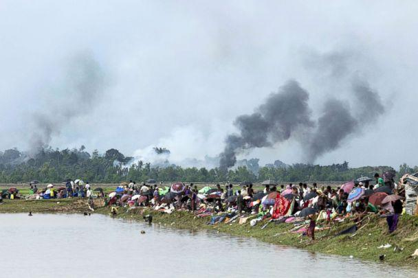 PHOTO: Smoke billows above what is believed to be a burning village in Myanmar's Rakhine state as members of the Rohingya Muslim minority take shelter in a no-man's land between Bangladesh and Myanmar in Ukhia, Bangladesh, Sept. 4, 2017. (KM Asad/AFP/Getty Images, FILE)