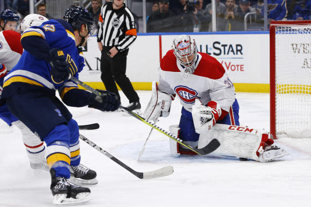 Montreal Canadiens goaltender Carey Price makes a save on a shot by St. Louis Blues' Jaden Schwartz, left, during the second period of an NHL hockey game Thursday, Jan. 10, 2019, in St. Louis. (AP Photo/Billy Hurst)