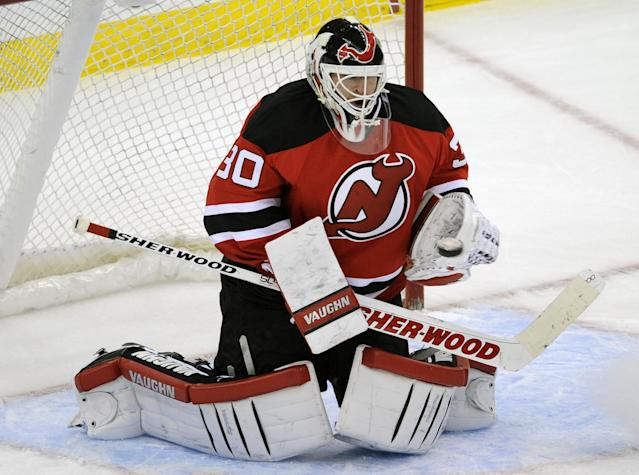 New Jersey Devils goaltender Martin Brodeur makes a save during the third period of an NHL hockey game against the Tampa Bay Lightning, Saturday, Dec. 14, 2013, in Newark, N.J. (AP Photo/Bill Kostroun)