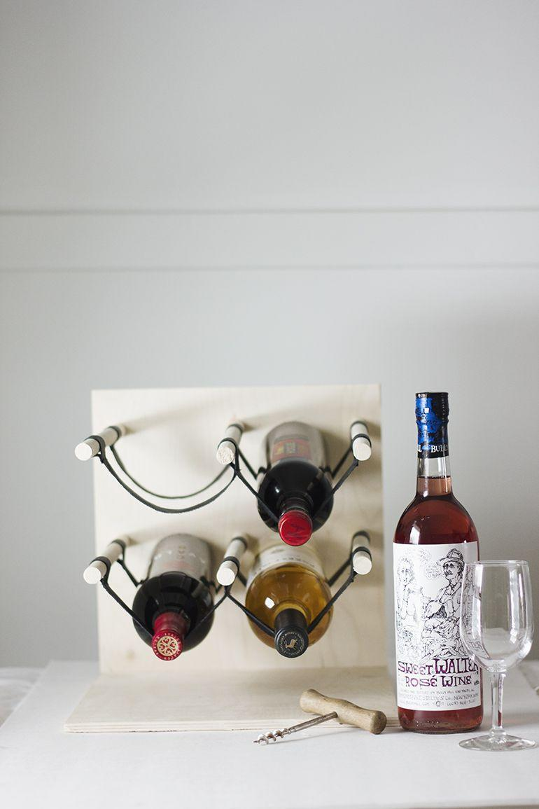 """<p>With basic woodworking skills—a bit of sawing, drilling, and gluing—you can create a special home for dad's favorite varietals. </p><p><a href=""""https://themerrythought.com/diy/diy-wood-leather-wine-rack/"""" rel=""""nofollow noopener"""" target=""""_blank"""" data-ylk=""""slk:Get the tutorial."""" class=""""link rapid-noclick-resp"""">Get the tutorial.</a></p><p><a class=""""link rapid-noclick-resp"""" href=""""https://www.amazon.com/Dewalt-DCD771C2-Cordless-Lithium-Ion-Compact/dp/B00ET5VMTU?tag=syn-yahoo-20&ascsubtag=%5Bartid%7C10072.g.27603456%5Bsrc%7Cyahoo-us"""" rel=""""nofollow noopener"""" target=""""_blank"""" data-ylk=""""slk:SHOP DRILL"""">SHOP DRILL</a></p>"""
