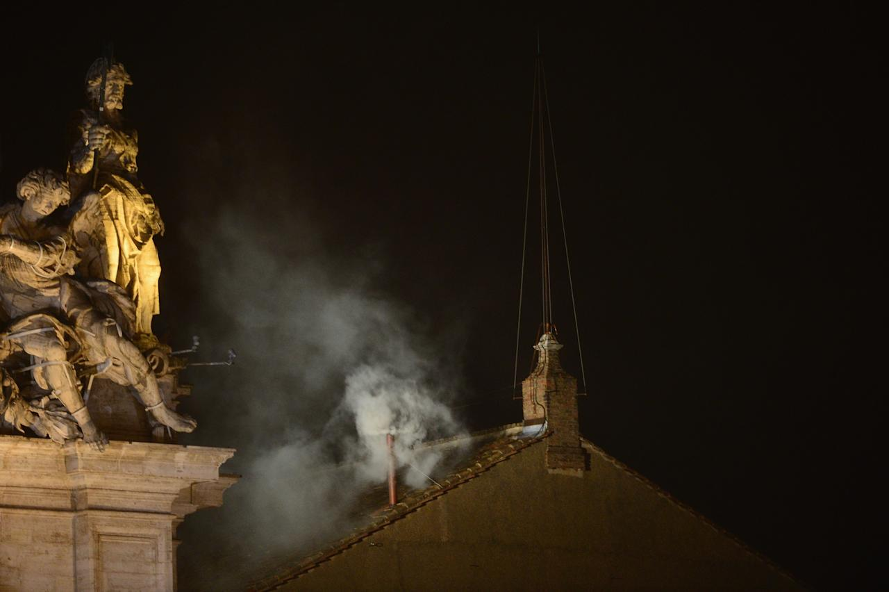 VATICAN CITY, VATICAN - MARCH 13: White smoke billows from the Sistine Chapel roof on the second day of the conclave on March 13, 2013 in Vatican City, Vatican. Pope Benedict XVI's successor - the 266th Pontiff - has been selected by the College of Cardinals in Conclave in the Sistine Chapel.  (Photo by Jeff J Mitchell/Getty Images)